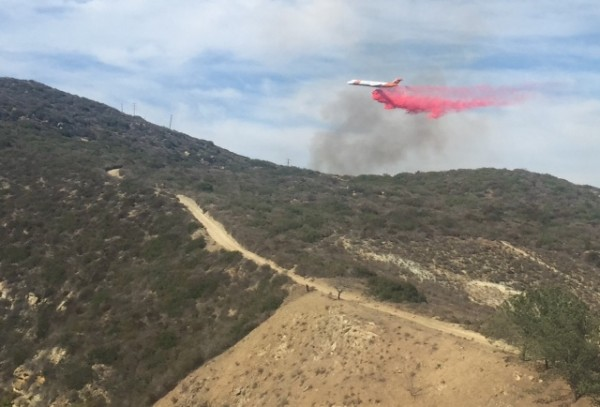 Firefighters attack the July 3 blaze in Laguna Canyon. Photo by Kelly Brooks
