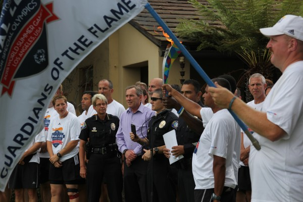 Police Chief Laura Farinella and Mayor Bob Whalen greet the torch runners.
