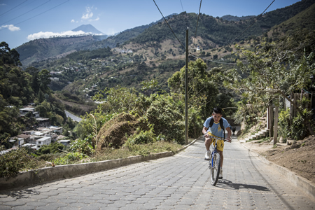Kevin pedals near his home in Antigua, Guatemala, with ease and cruises the 10 km journey to school through cows and traffic like a New York bike messenger.