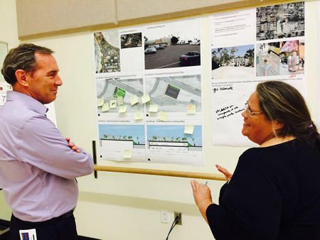 Mayor Bob Whalen, left, absorbs comments on downtown land use ideas from resident Penny Milne.Photo by Jennifer Erickson.