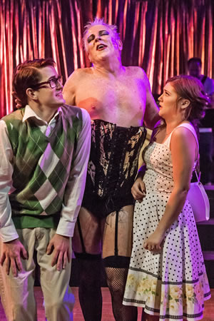 "Dr. Frank'N'Furter (Jeff Paul - center) sings ""Sweet Transvestite"" to Brad (Nic Parsons) and Janet (Kelly Vernon). Photos by Mitch Ridder"