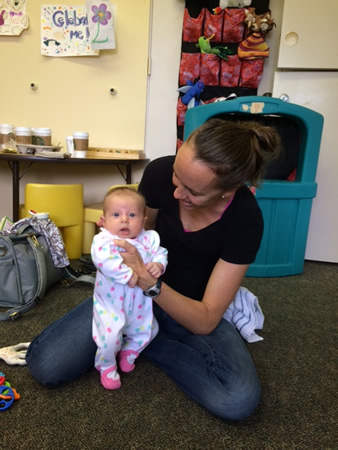 Erin Beutin holds Sienna Cleary at the Mommy and Me get-together Wednesdays at 10 a.m. at Laguna Beach United Methodist Church, 21632 Wesley Drive.