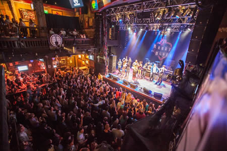 Radio station fans tune in for a live benefit show at the House of Blues in Anaheim.