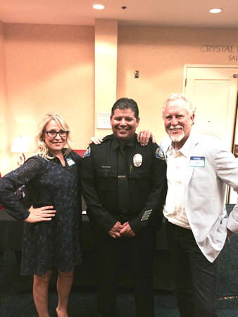 Zach Martinez flanked by Chamber of Commerce Executive Director Laura Henkels and President Gregg Abel.