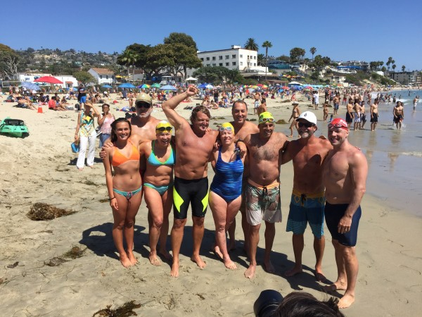 Swimmers and support kayakers celebrate their feat, from left, Faith Hale, Jamie Glazer, Lynn Kubasek, Thomas Hale, Patsee Ober, Rich Selin,  Brett Rose, Eric Zuziak and Roddy Teeple.