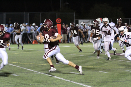 Quarterback Jack Simon carries the ball against Bolsa Grande.