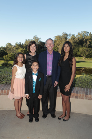 Event co-chairs Janice and John Markley, center, flanked by Wooden Floor students, from left, Olivia Aviles, Matteo Zarate and Elizabeth Alvarez
