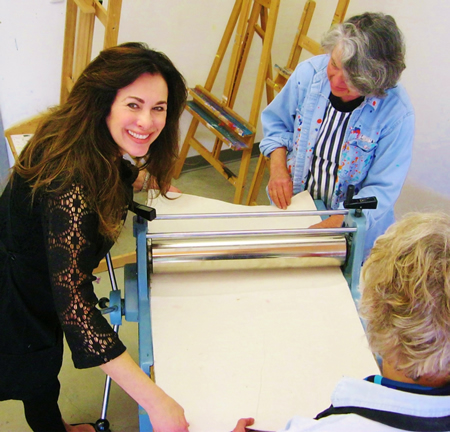 Printmaker Carla Meberg offers pointers.Photo by Mike Tauber.