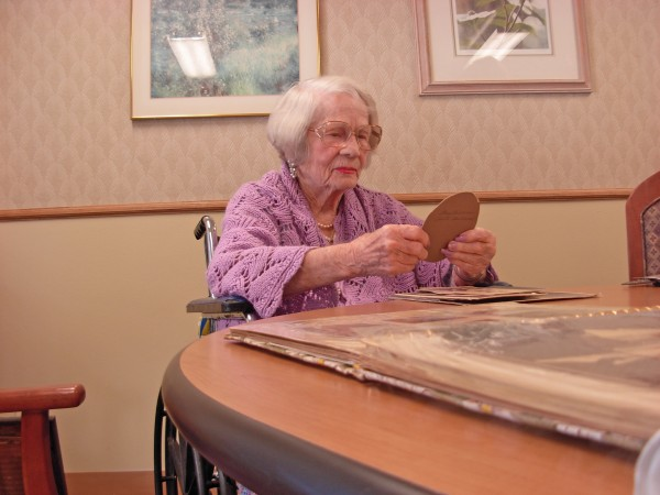 Joyce Lowell peruses photos from the family archive in 2012.