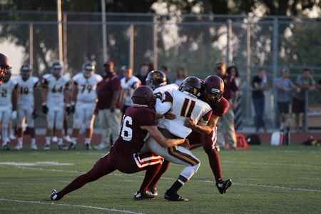 Defensive teamwork against Valley Christian. Photos by Dante Fornaro