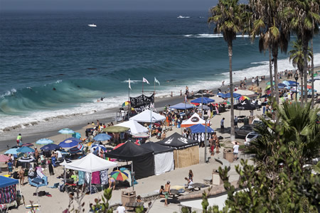 Spectators and vendors line Aliso Beach for the oldest skimboard contest in the world, the 39th annual skimboard world championships.