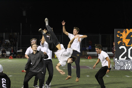 Here, seniors, and all other classes, perform in a halftime skit, a homecoming game tradition.