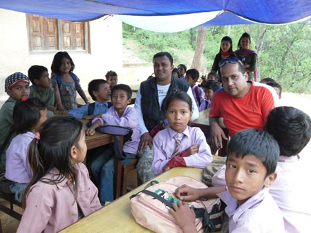 R Star program manager Rabin Situala among students at a school in a quake-damaged village in Nepal