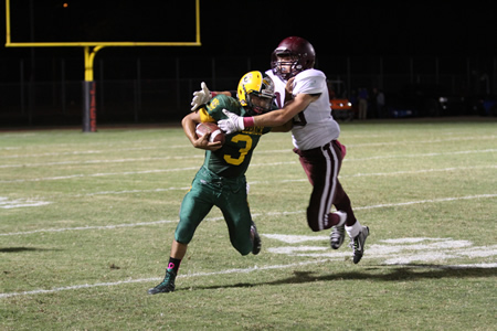 Lance Stewart makes a tackle against Saddleback.