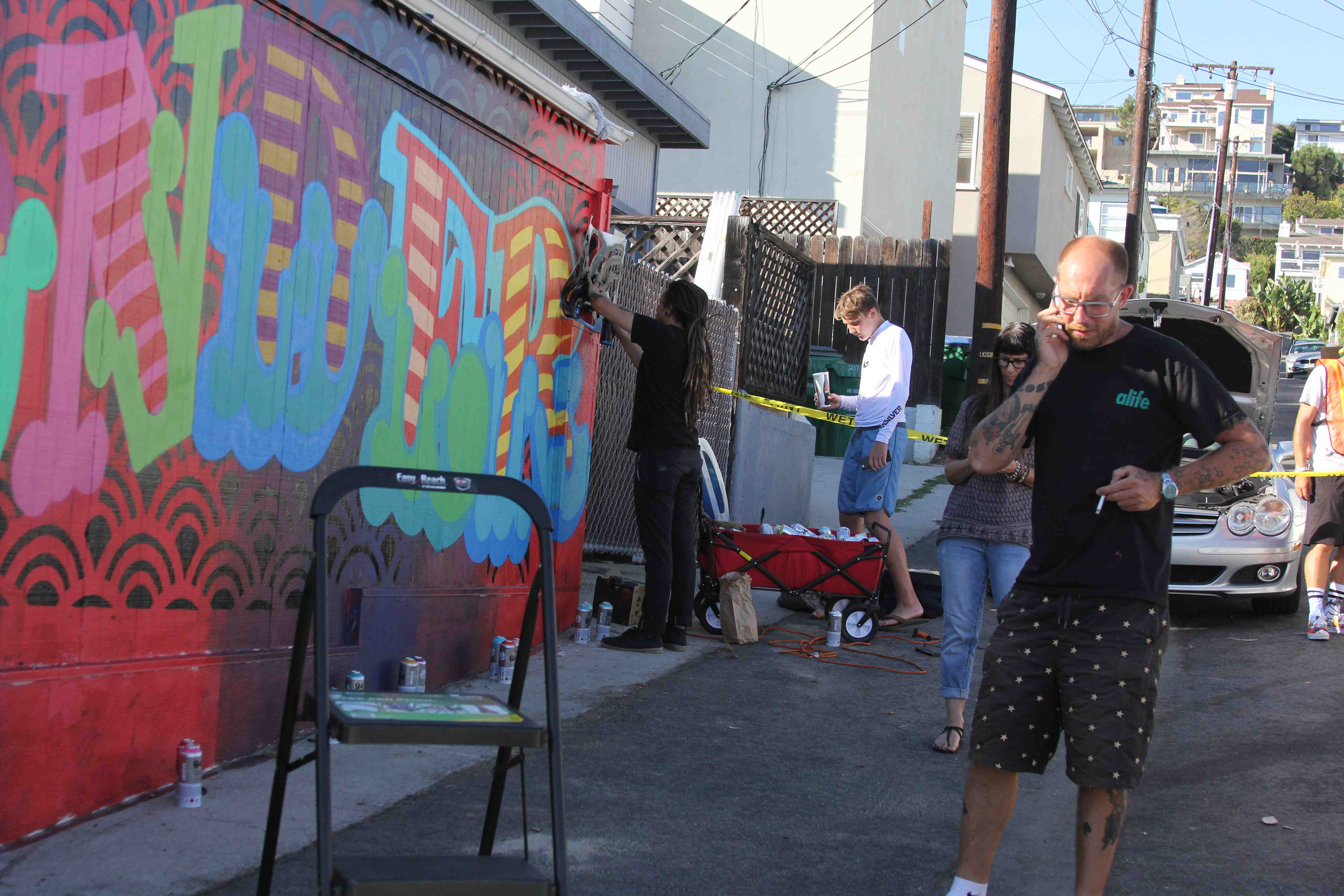 """Photo by Andrea Adelson Street artist Ben Eine finishing the """"Wonder"""" mural on Aug. 28. Photo by andrea Adelson."""