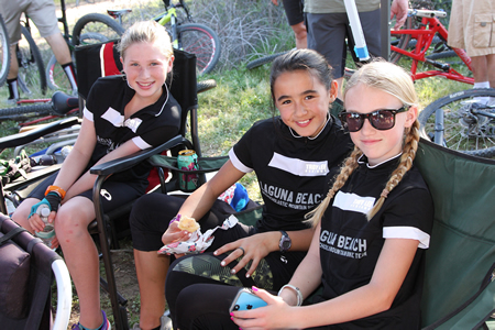 Bike team members, from left, Whitney Winefordner, Tasha Zentil and Katelyn Kolberg ready to resume training. Photo by Sharael Kolberg