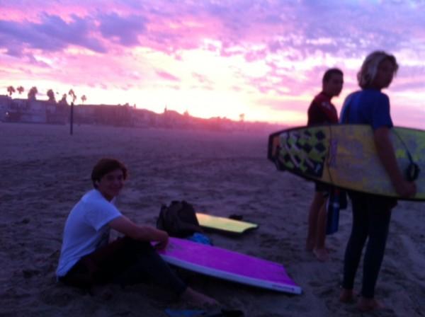 The team on the sand at sunrise.
