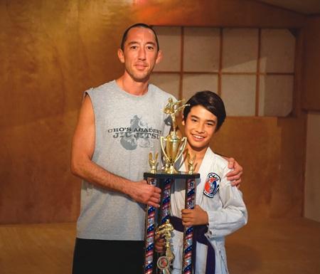 Studio owner Jacob Cho, left, with Jacob Burdiek.