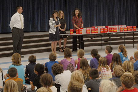 Dictionary distribution to TOW third graders.