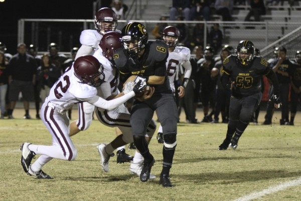Sophomore Blake Lusk makes the tackle.