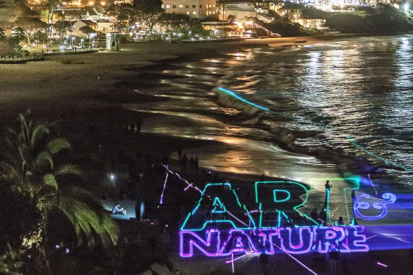 Artist Laddie John Dill projected laser light on the coastline for his Art & Nature installation. Photo by Mitch Ridder