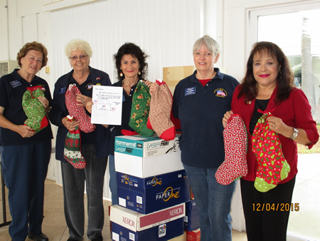 American Legion Auxiliary members from left, Sandi Werthe, Jean Law, Diane Connell, Beth Johnsen with Words of Comfort, Hope & Promise founder Cynthia Martinez.