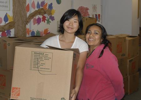 Rotary's high school Interact Club member Haro Urushido helps Juana Sanchez.