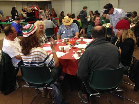 A community effort organizes a breakfast party for the town's homeless population.