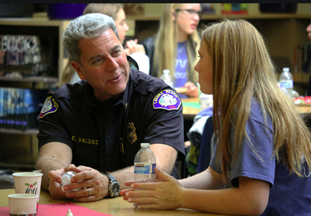 Four firefighters, including Division Chief Ed Valdez, met with their benefactors, including student Tia Mills over lunch.