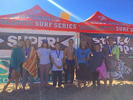 Coach Alisa Cairns, third from left, shares the spotlight with team members, from left, Claire Kelly, Lola Fisher, Jameson Roller, Travis Booth, Jake Levine, Trey Lockhart,  Photo courtesy LBHS Surf Team.