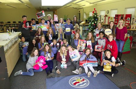 Thurston Middle School students collected four large boxes of toys and sports equipment to donate to the Spark of Love Toy Drive.