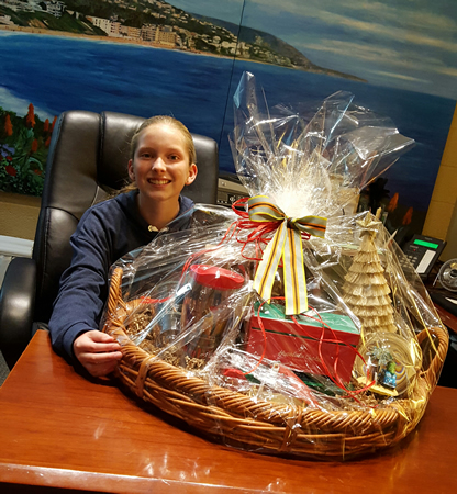 Thurston seventh-grader Rhiannon Seely won a Tommy Bahama gift basket during the Saturday, Nov. 28, shop local promotion.Photo courtesy LB Chamber of Commerce.