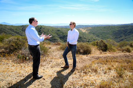OCTA Chair Jeff Lalloway, left, and Derek Ostensen, a Laguna Canyon Foundation board member, at the tip of acreage in Laguna Beach purchased by OCTA as open space in April. Photo by Jody Tiongco.