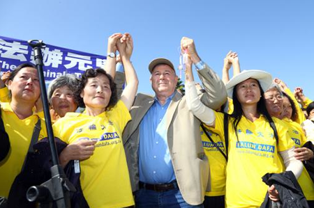 The congressman spoke at a rally protesting China's persecution of Falun Gong practitioners at the Marina Green Park in Long Beach in October 2013.