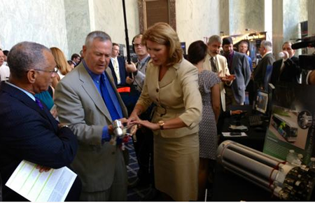 Rep. Rohrabacher and NASA Administrator Charles Bolden examine components from a NASA project during an open house on Capitol Hill in July 2013.
