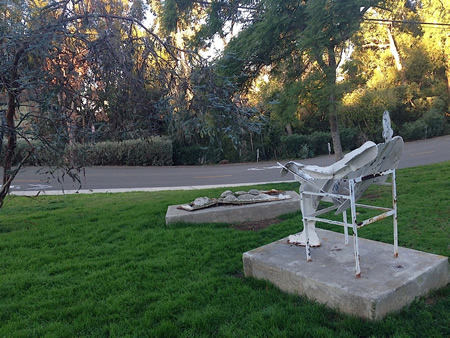Leonard Glasser's sculptures of a man and woman sunbathing are across the street from Nita Carman's home.