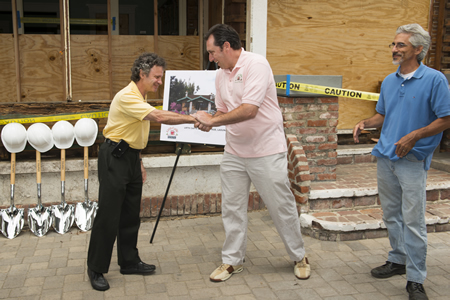 As  construction got underway in 2014 at the Urth Caffe, Council member Steve Dicterow, left. congratulates owner Shallom Berkman, center, and architect Todd Skendarian.