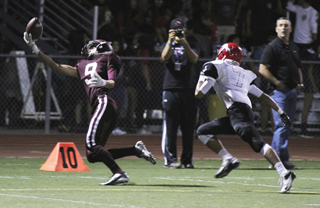 Laguna Beach High School junior Ryan Blaser snags one of five passes for 93 yards and a touchdown during a game against Westminster in September. Photo by Dante Fornaro.