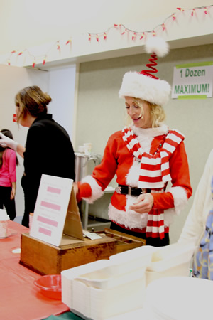 Elf-like Mary Schmidt turned cashier at the Presbyterian Church tamale dinner benefit for La Playa Center.