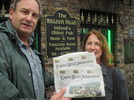 Roger and Ellen Kempler put down their pints long enough to brave pouring rain in June outside the Brazen Head, in Dublin, Ireland's oldest pub, dating back to 1198.