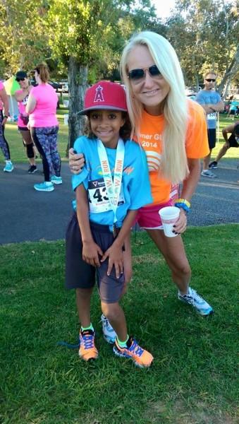 Laguna resident Kylie Schuyler congratulates a G.L.O.W. Run participant last October.