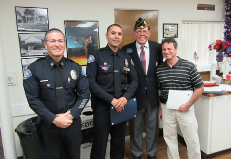 From left, police Captain Darin Lenyi, Officer James Michaud, Legion Commander Richard Moore and Mayor Steve Dicterow.