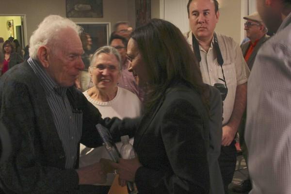 Local Arnold Hano greets Kamala Harris.
