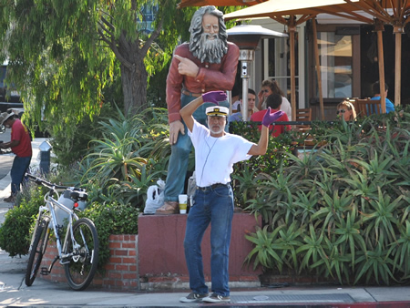 Michael Minutoli inhabits the role as Laguna Beach's current greeter and figures in a documentary on the topic that has its premiere next week.
