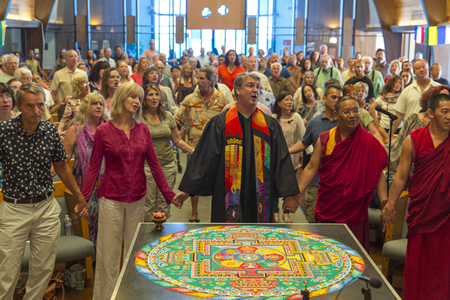 The Rev. BJ Beu, center, takes part in a ceremony at the Neighborhood Congregational Church last October marking the completion of a sand mandala by visiting Tibetan monks.Photo by Tom Lamb.