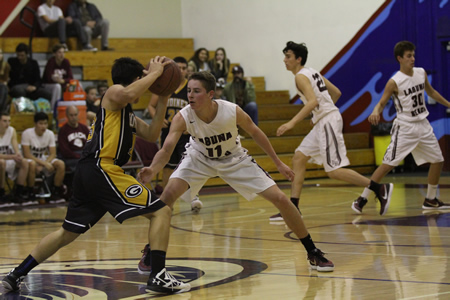 Breaker player Isaac Wulff defends against Godinez, which lost the game 54-37 Friday, Jan. 29.
