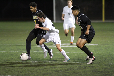 Breaker player James Langton battles for the ball against Godinez, which won the contest 2-1 Friday, Jan. 29