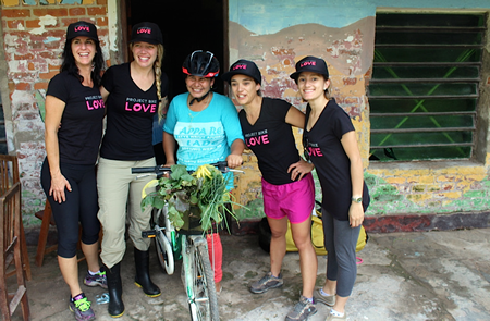 Lidia Rosa, center, who used to carry goods on her head, is overjoyed by the basket on her new bike, delivered by Project Bike Love support-ers, from left, Amy Stonich, Erin Machan and sisters Belen and Lu-pe Ramirez. Photo courtesy of Bike Project Love.