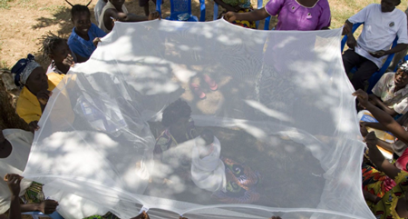 A mother and child in Ghana enclosed in mosquito netting.Photo courtesy of John Robinson for Episcopal Relief & Development