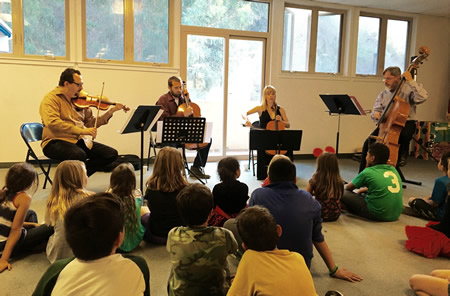Hutchins Consort members preceded a museum performance with one at the Boys and Girls Club.